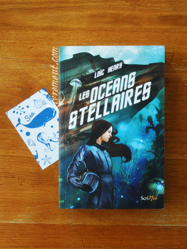 Marque page et lecture Les océans stellaires de Loïc Henry